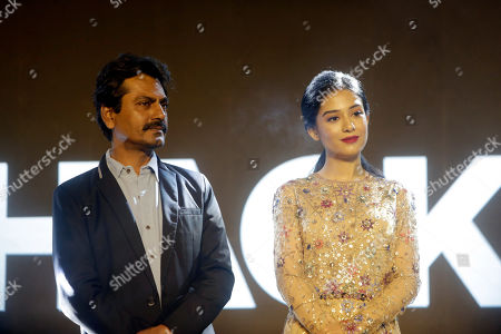 """Bollywood actors Nawazuddin Siddiqui, left,and Amrita Rao attend the music launch of the movie """"Thackeray,"""" in Mumbai, India, . The biographical film on the life of Hindu nationalist Shiv Sena party founder Bal Thackeray is scheduled to be released on Jan. 25"""