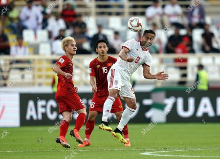 Omid Ebrahimi of Iran heading the ball in front of Nguy?n V?n ToË?n of Vietnam during Vietnam v Iran at the Al-Nahyan Stadium in Abu Dhabi, United Arab Emirates, AFC Asian Cup, Asian Football championship