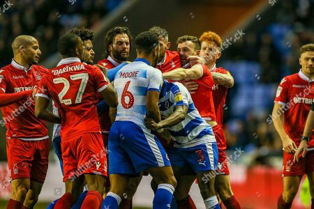 Nottingham Forest defender Danny Fox (4) tries to reach Reading defender Andy Yiadom (3)  during the EFL Sky Bet Championship match between Reading and Nottingham Forest at the Madejski Stadium, Reading