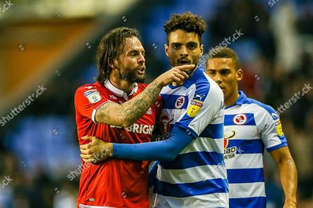 Nottingham Forest defender Danny Fox (4) points towards Reading defender Andy Yiadom (3)  during the EFL Sky Bet Championship match between Reading and Nottingham Forest at the Madejski Stadium, Reading