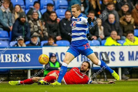 Nottingham Forest defender Danny Fox (4) tackles Reading forward Jon Dadi Boovarsson (23) during the EFL Sky Bet Championship match between Reading and Nottingham Forest at the Madejski Stadium, Reading