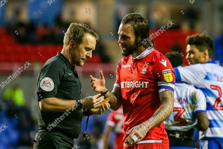 Nottingham Forest defender Danny Fox (4) argues with referee Oliver Langford during the EFL Sky Bet Championship match between Reading and Nottingham Forest at the Madejski Stadium, Reading