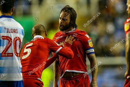 Nottingham Forest defender Danny Fox (4) held back by Nottingham Forest midfielder Adlene Guedioura (5) during the EFL Sky Bet Championship match between Reading and Nottingham Forest at the Madejski Stadium, Reading