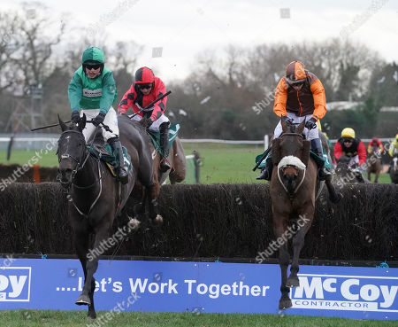 Warwick Racecourse The McCoy Contractors Civil Engineering Classic Handicap Steeple Chase. Impulsive Star (right) ridden by Sam Whaley-Cohen clears the final fence along side Calett Mad ridden by James Bowen.