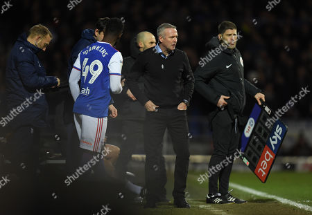 Ipswich Town Manager Paul Lambert looks on as Simon Dawkins of Ipswich Town comes into the game