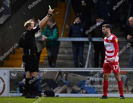Stock Image of Bryn Morris of Wycombe Wanderers is shown a yellow card by Trevor Kettle match referee