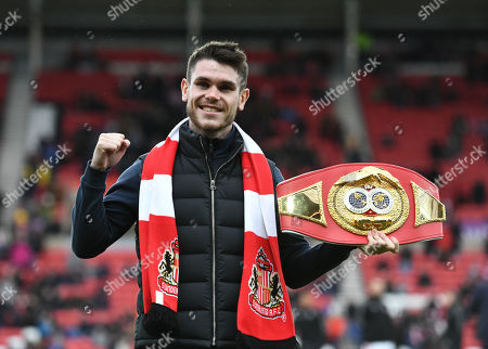 Boxer Tom Ward who is also a Sunderland fan is presented to the fans before kick off with his belt
