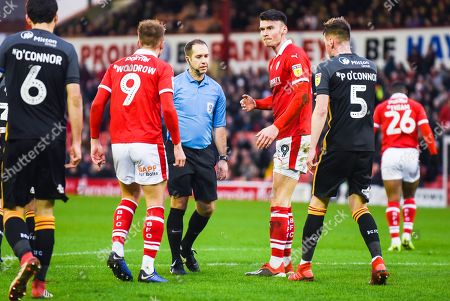 Jeremy Simpson (Referee) talks to Cauley Woodrow of Barnsley (9) and Kieffer Moore of Barnsley (19) and Paudie O'Connor of Bradford City (5) during the EFL Sky Bet League 1 match between Barnsley and Bradford City at Oakwell, Barnsley