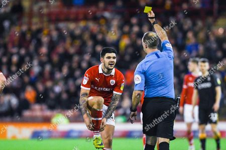 Jeremy Simpson (Referee) yellow cards Alex Mowatt of Barnsley (27) during the EFL Sky Bet League 1 match between Barnsley and Bradford City at Oakwell, Barnsley
