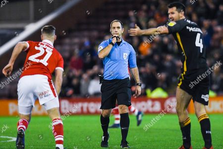 Jeremy Simpson (Referee) blows up to penalise Ryan McGowan of Bradford City (4) tackle on Mike-Steven Bahre of Barnsley (21) during the EFL Sky Bet League 1 match between Barnsley and Bradford City at Oakwell, Barnsley
