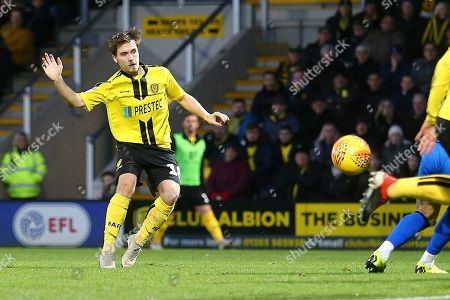 Stock Image of Burton Albion midfielder William Miller (18) shoots at goal during the EFL Sky Bet League 1 match between Burton Albion and Gillingham at the Pirelli Stadium, Burton upon Trent