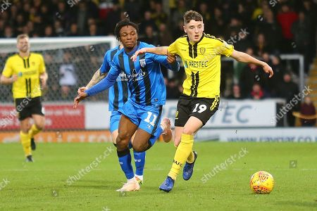 Burton Albion Reece Hutchinson (19) and Gillingham FC midfielder Regan Charles-Cook (11) during the EFL Sky Bet League 1 match between Burton Albion and Gillingham at the Pirelli Stadium, Burton upon Trent