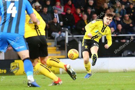 Burton Albion midfielder Ben Fox (12) shoots at goal during the EFL Sky Bet League 1 match between Burton Albion and Gillingham at the Pirelli Stadium, Burton upon Trent