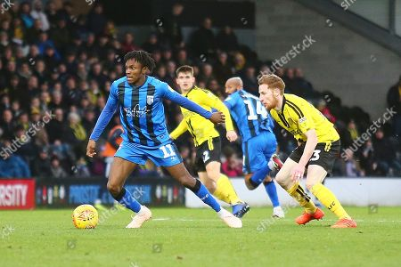 Gillingham FC midfielder Regan Charles-Cook (11) shields the ball from Burton Albion's Reece Hutchinson (23) during the EFL Sky Bet League 1 match between Burton Albion and Gillingham at the Pirelli Stadium, Burton upon Trent