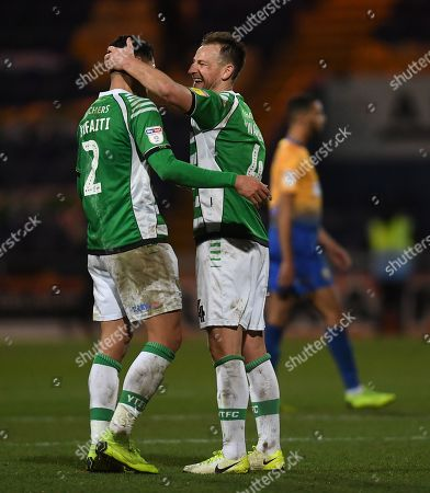 Adel Gafaiti and Gary Warren of Yeovil Town celebrate their team's victory at full time