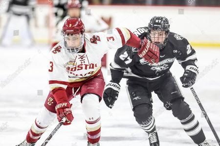 Boston College defensemen Luke McInnis (3) pushes back Providence College forward John McDermott (26) during a NCAA hockey game, in Boston