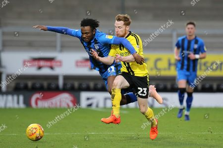 Gillingham midfielder Regan Charles-Cook and Burton  Albion midfielder Stephen Quinn challenge for the ball during the EFL Sky Bet League 1 match between Burton Albion and Gillingham at the Pirelli Stadium, Burton upon Trent