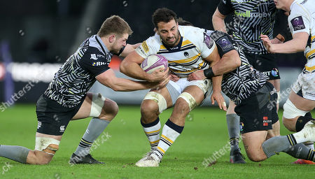 Marco Mama of Worcester Warriors is tackled by Olly Cracknell and Scott Baldwin of Ospreys.