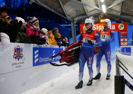 Chris Mazdzer (L) and Jayson Terdiman of USA in the finish area after the second run of the doubles competition for the Luge World Cup in Sigulda, Latvia, 12 January 2019.