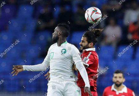 Saudi Arabia's midfielder Abdulaziz Al-Bishi, left, heads for the ball with Lebanon's midfielder Haytham Faour, right, during the AFC Asian Cup group E soccer match between Lebanon and Saudi Arabia at Al Maktoum Stadium in Dubai, United Arab Emirates