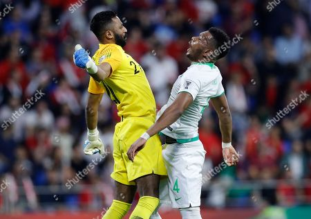 Saudi Arabia's defender Ali Albulayhi, right, celebrates with his goalkeeper Mohammed Al-Owais, left, after their teammate Fahad Al Muwallad scores the opening goal, during the AFC Asian Cup group E soccer match between Lebanon and Saudi Arabia at Al Maktoum Stadium in Dubai, United Arab Emirates
