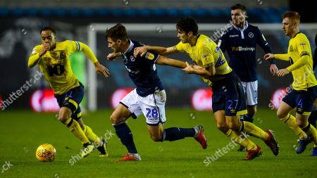 Stock Photo of Lewis Travis of Blackburn Rovers and Ryan Leonard of Millwall