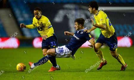 Stock Photo of Ryan Leonard of Millwall battles with Elliott Bennett (l) and Lewis Travis of Blackburn Rovers (r)