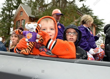 Josh White displays his Clemson Tiger while riding in the parade for the Clemson Tigers, in Clemson, S.C., Clemson defeated Alabama 44-16 in the College Football Playoff championship game Monday Jan. 7