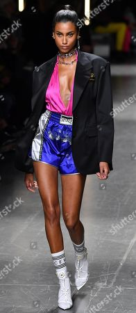 Dutch model Imaan Hammam presents a creation from the Fall/Winter 2019/2020 collection by Versace during the Milan Men's Fashion Week, in Milan, Italy, 12 January 2019. Fall/Winter 2019/20 collections are presented at the Milano Moda Uomo from 11 to 14 January.