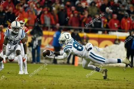 Stock Image of Indianapolis Colts wide receiver Dontrelle Inman (15) and Kansas City Chiefs cornerback Steven Nelson (20) watch as Colts wide receiver Chester Rogers (80) can't hold on to a pass during the second half of an NFL divisional football playoff game in Kansas City, Mo