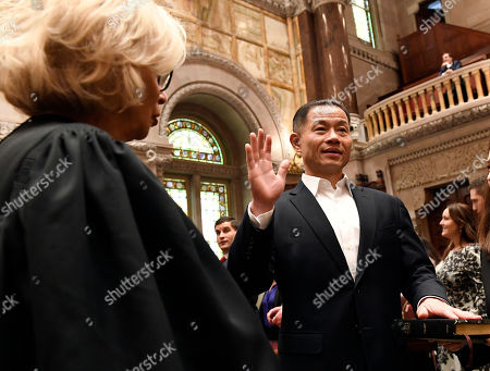 Stock Image of New York Court of Appeals Chief Judge Janet DiFiore, left, administers the oath of office to John Liu, D-Queens, during opening day of the legislative session in Albany, N.Y. Liu is the first Chinese-American elected to the state senate