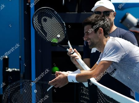 Serbia's Novak Djokovic talks with his coach Marian Vajda during a practice session at the Australian Open tennis championships in Melbourne, Australia