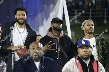 Los Angeles Lakers players Lebron James (C), JaVale McGee (L) and Michael Beasley (R) attend the NFC Divisional Round playoff NFL American Football game between the Los Angeles Rams and the Dallas Cowboys at the LA Memorial Coliseum in Los Angeles, California, USA, 12 January 2019.