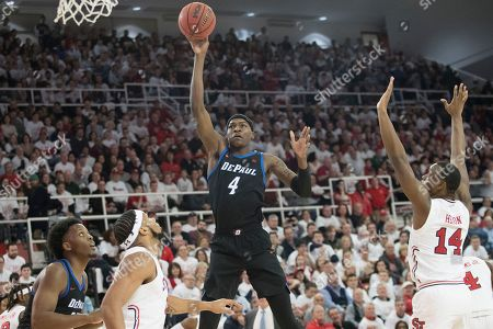 DePaul forward Paul Reed (4) shoots in the first half of an NCAA college basketball game against St. John's, in New York