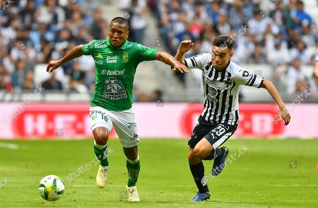 Carlos Rodriguez (R) of Rayados de Monterrey vies for the ball against Pedro Aquino (L) of Leon during the Clausura Tournament 2019 soccer match between Rayados de Monterrey and Leon at the BBVA Stadium in Monterrey, Mexico, 12 January 2019.