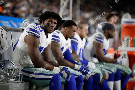 Dallas Cowboys running back Rod Smith sits on the bench during their loss against the Los Angeles Rams in an NFL divisional football playoff game, in Los Angeles
