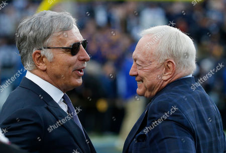 Los Angeles Rams owner Stan Kroenke and Dallas Cowboys owner Jerry Jones in action during the NFC Divisional Round playoff game between the game between the Los Angeles Rams and the Dallas Cowboys at the Los Angeles Coliseum in Los Angeles, California