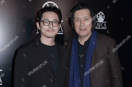 Stock Photo of Steven Yeun, Lee Chang-Dong. Steven Yeun, left, and Lee Chang-Dong attend the 44th Annual Los Angeles Film Critics Association Awards at the InterContinental Century City Hotel, in Los Angeles