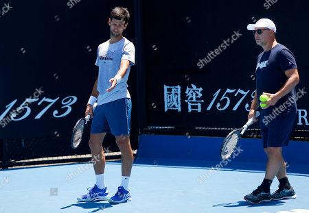 Novak Djokovic of Serbia in action with each Marian Vajda during practice