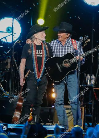 Willie Nelson, George Strait. Willie Nelson, left, and George Strait perform at Willie: Life & Songs Of An American Outlaw at Bridgestone Arena, in Nashville, Tenn