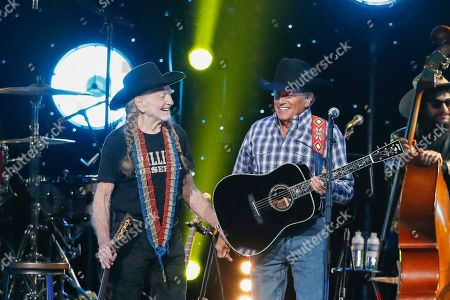 Stock Image of Willie Nelson, George Strait. Willie Nelson, left, and George Strait perform at Willie: Life & Songs Of An American Outlaw at Bridgestone Arena, in Nashville, Tenn