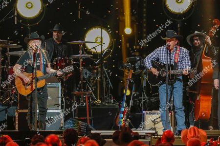 Stock Photo of Willie Nelson, George Strait. Willie Nelson, left, and George Strait perform at Willie: Life & Songs Of An American Outlaw at Bridgestone Arena, in Nashville, Tenn