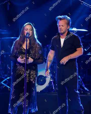 Stock Picture of Carlene Carter, John Mellencamp. Carlene Carter, left, and John Mellencamp perform at Willie: Life & Songs Of An American Outlaw at Bridgestone Arena, in Nashville, Tenn