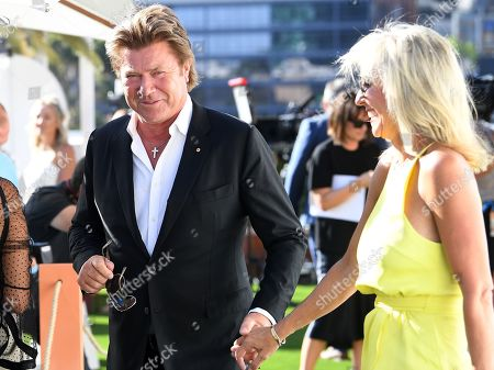 Stock Picture of Australian presenter Richard Wilkins (L) and his girlfriend Virginia Burmeister (R) attend the Crown IMG Tennis party at the Crown in Melbourne, Australia, 13 January 2019. The Australian Open tennis tournament will take place from 14 January to 27 January 2019.