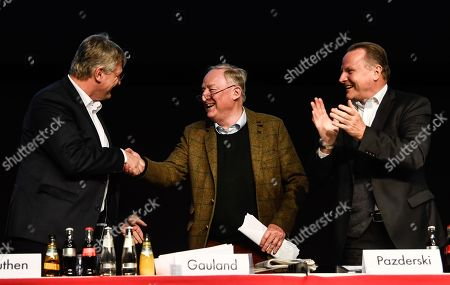 Aternative fuer Deutschland (AfD) party faction co-chairman in the German parliament Bundestag Alexander Gauland (C) receives congratulations from  Aternative for Germany (AfD) party chairman Joerg Meuthen (L) , next to deputy chairman Georg Pazderski (R) during the European election convention of the AfD in Riesa, Germany, 13 January 2019. The AfD party members gather from 11 to 14 January 2019 in Riesa, for the election of their candidates for the European elections. European elections will take place from 23 to 26 May 2019.