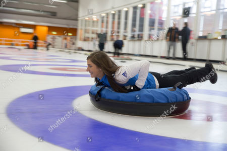 Eve Muirhead tries out human curling