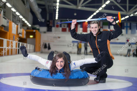 Eve Muirhead tries out human curling at the intu Braehead rink with the help of ice technician and curler, Colin Mouat.