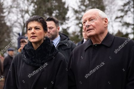 Stock Photo of Co-leaders of The Left (Die Linke) party faction Sahra Wagenknecht (L) and Fraction chairman in the federal state of Saarland Oskar Lafontaine talk after they brought bouquets to the grave of German revolutionary socialist Rosa Luxemburg at the Memorial to the Socialists in Berlin, Germany, 13 January 2019. Luxemburg was executed on 15 January 1919 for her political beliefs, after being arrested for taking part in workers general strike called 'Spartacist uprising' against government of Social Democratic Party of Germany.