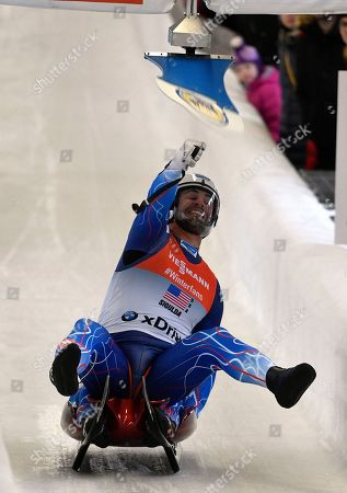 Stock Photo of Chris Mazdzer Jayson Terdiman. Chris Mazdzer and Jayson Terdiman of United States hit the target during the team relay race at the Luge World Cup event in Sigulda, Latvia
