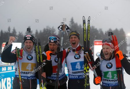 Austria's, from left: Dominik Landertinger, Tobias Eberhard, Julian Eberhard and Simon Eder celebrate third place in the men's 4x7.5 km relay competition at the Biathlon World Cup event in Oberhof, Germany